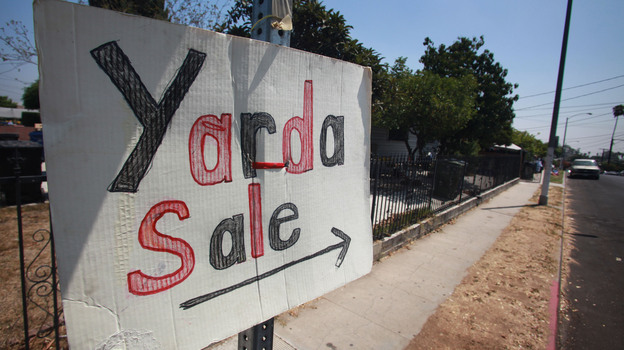 Spanglish, a mixture of English and Spanish, has been spoken for more than a century. A sign in Spanglish advertises a yard sale in Los Angeles in 2009. (Landov)