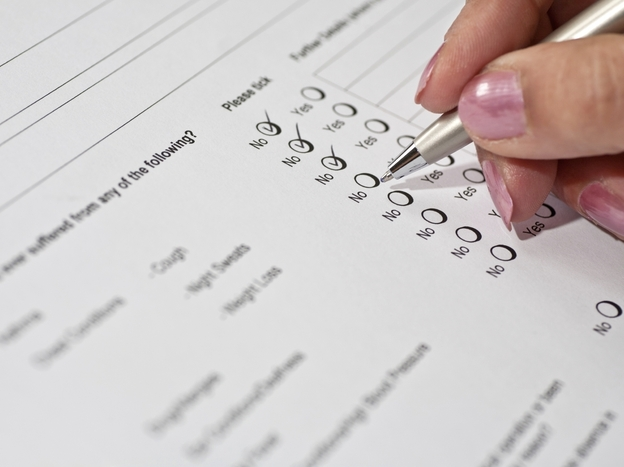 Health risk questionnaires and other wellness programs are becoming a popular way for employers to encourage employee health and, ultimately, reduce health care costs. (grandaded/iStockphoto.com)