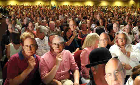 The audience at last night's taping of Wait Wait... Don't Tell Me! in Portland, Maine, holding up faces of Carl Kasell.