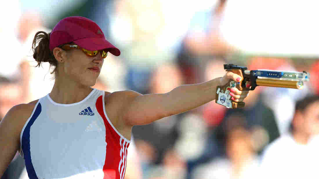 Elodie Clouvel of France shoots in the combined running/shooting event during the modern pentathlon World Championships in May in Rome, Italy. She'll compete in the Olympics Sunday.