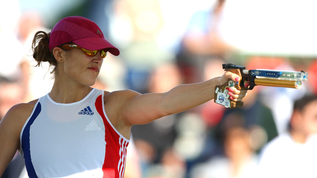 Elodie Clouvel of France shoots in the combined running/shooting event during the modern pentathlon World Championships in May in Rome, Italy. She'll compete in the Olympics Sunday. (Getty Images)