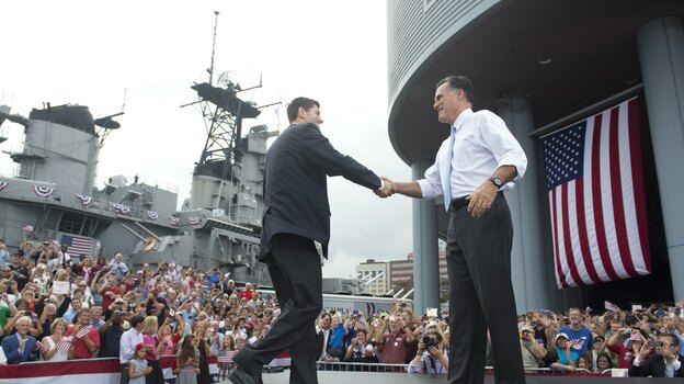 Rep. Paul Ryan of Wisconsin shakes hands with Mitt Romney as he's introduced as Romney's vice presidential running mate Saturday in Norfolk, Va. The USS Wisconsin is in the background. (AFP/Getty Images)