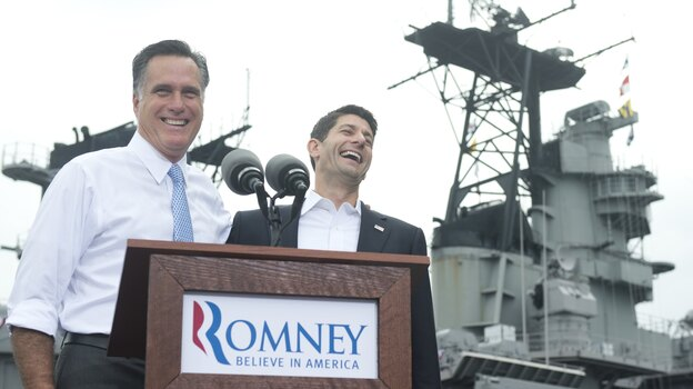Republican presidential candidate Mitt Romney announces Wisconsin Rep. Paul Ryan as his running mate during a campaign rally in Norfolk, Va., on Saturday. (AFP/Getty Images)