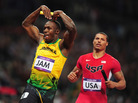 "Usain Bolt of Jamaica celebrates his relay team's world record by doing the ""mobot"" move, made famous by Mo Farah of Britain. Bolt crossed the finish line in front of Ryan Bailey of the United States."