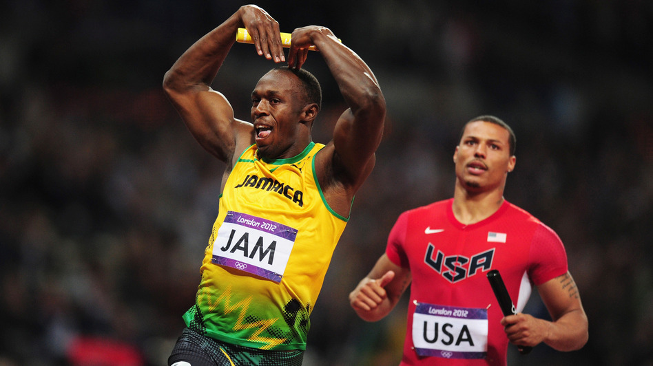 "Usain Bolt of Jamaica celebrates his relay team's world record by doing the ""mobot"" move, made famous by Mo Farah of Britain. Bolt crossed the finish line in front of Ryan Bailey of the United States. (Getty Images)"