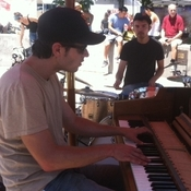 Pianist Kirby Lee Hammel and drummer Jake Alexander perform as Clangin' & Bangin' at an Oakland farmers market.