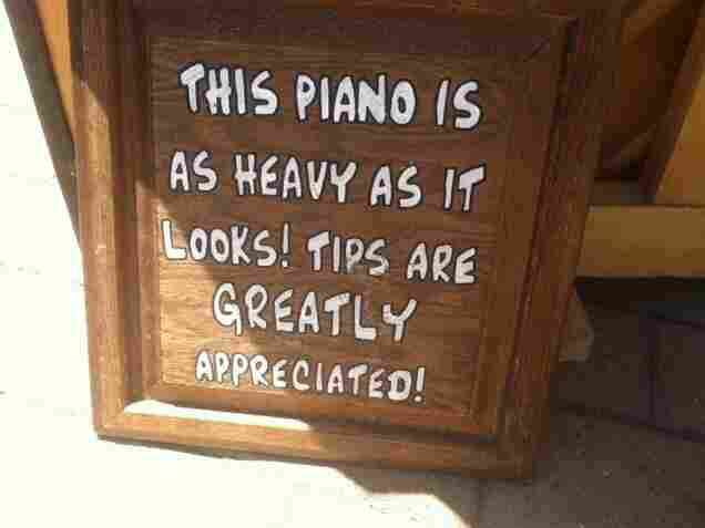 """Alexander says performing outdoors with a real piano attracts """"a lot of pity tips."""""""