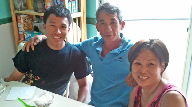 When his parents Tuy (center) and Mydung (right) Lam lost their jobs, electrical engineering major Louis Lam enlisted in the Navy. (NPR)
