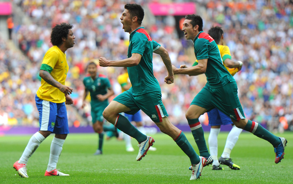 Oribe Peralta of Mexico celebrates scoring his second goal as Mexico beat Brazil, 2-1, to win Olympic gold medal in London's Wembley Stadium.