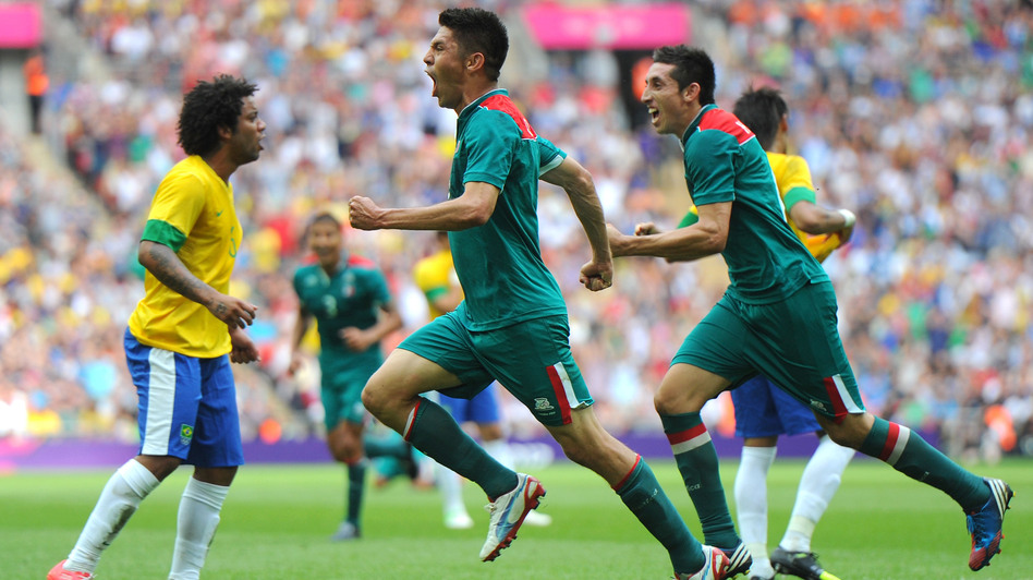 Oribe Peralta of Mexico celebrates scoring his second goal as Mexico beat Brazil, 2-1, to win Olympic gold medal in London's Wembley Stadium. (Getty Images)