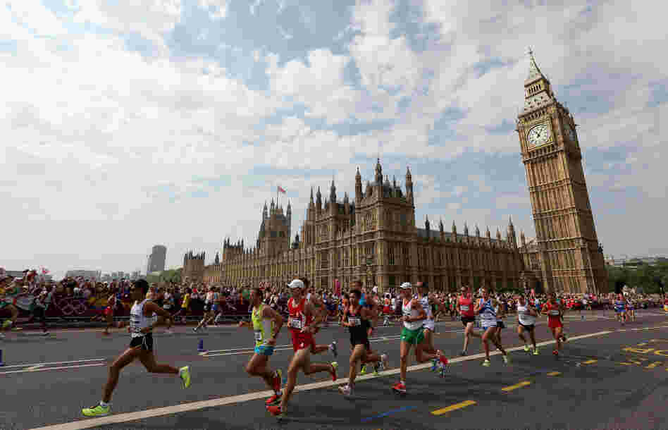 Athletes run along Westminster Bridge next to the Palace of Westminster as they compete in the Men's Marathon in London.
