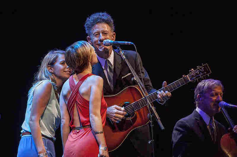 Singers Aoife O'Donovan (left) and Kat Edmondson harmonized with Lovett.