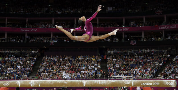 In an iconic moment, Gabrielle Douglas performs on the balance beam during the artistic gymnastics women's individual all-around competition at the 2012 Summer Olympics in London.