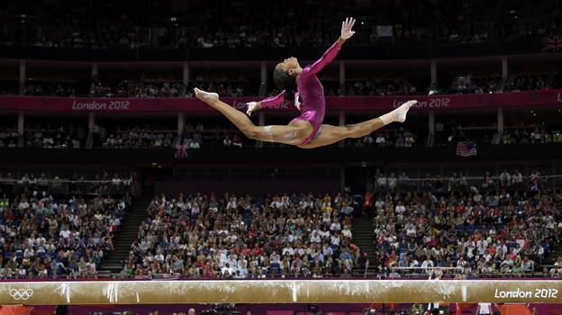 In an iconic moment, Gabrielle Douglas performs on the balance beam during the artistic gymnastics women's individual all-around competition at the 2012 Summer Olympics in London. (AP)