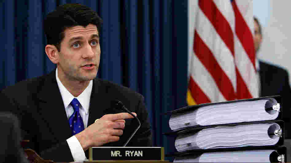 Rep. Paul Ryan, R-Wis., points to piles of the health care overhaul legislation during a markup hearing before the U.S. House Budget Committee last year in Washington, D.C.