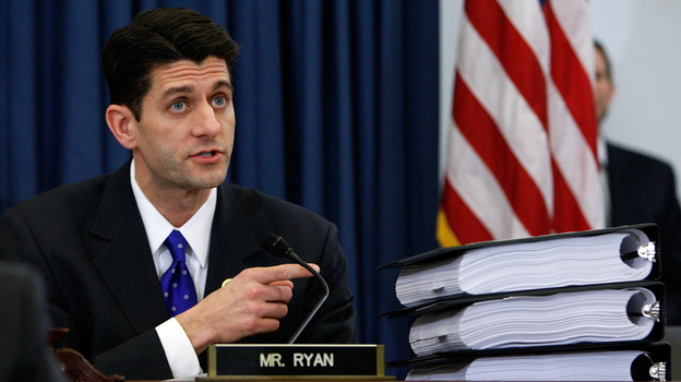 Rep. Paul Ryan, R-Wis., points to piles of the health care overhaul legislation during a markup hearing before the U.S. House Budget Committee last year in Washington, D.C. (Getty Images)