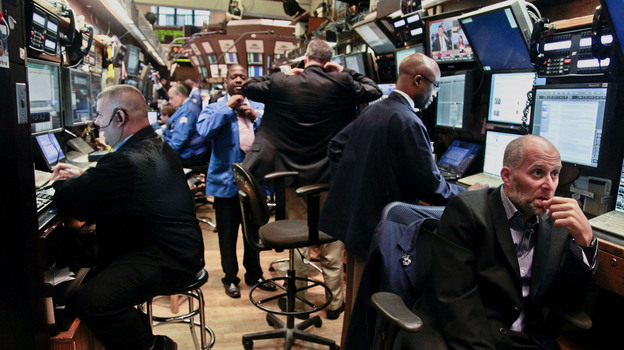Traders prepare for the start of early trading at the New York Stock Exchange. Some say there's been a loss of faith in the stock market's return on investment over the last 15 years. (AP)