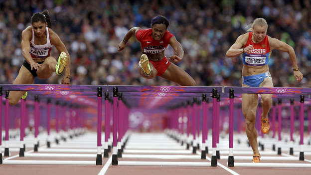 Turkey's Nevin Yanit (from left) United States' Kellie Wells and Russia's Tatyana Dektyareva compete in a women's 100-meter hurdles semifinal. Exactly how many yards is that? (AP)