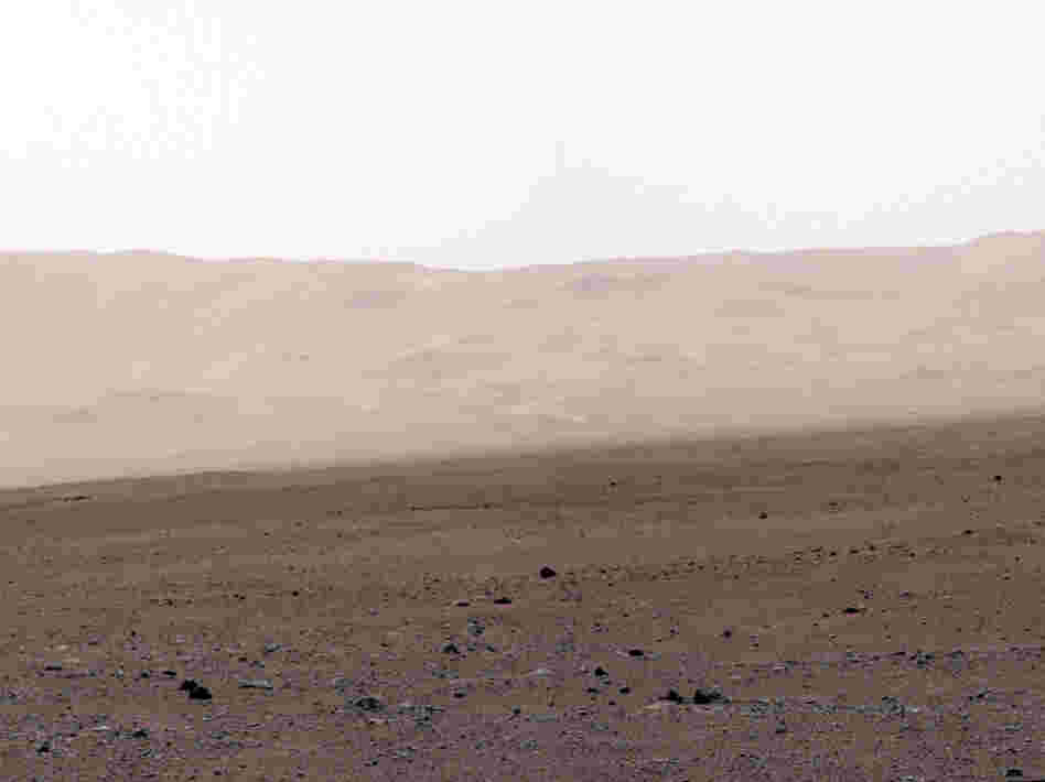 This image of the crater wall is north of the landing site, or behind the rover. Here, a network of valleys believed to have formed by water erosion enters Gale Crater from the outside. This is the first view scientists have had of a fluvial system - one relating to a river or stream — from the surface of Mars.