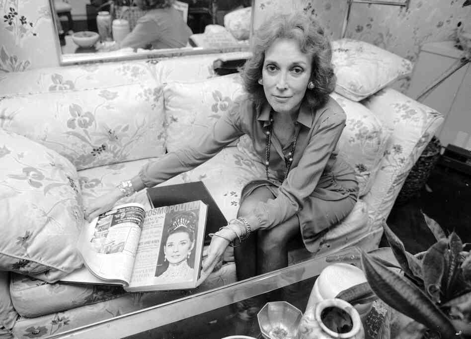 Helen Gurley Brown, editor of Cosmopolitan magazine, poses in her office