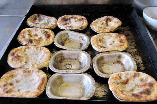 At F. Cooke's Pie and Mash Shop, Robert Cooke still uses the same pans his father cooked in.