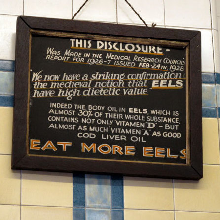 A sign on the wall at F. Cooke's shop in London.