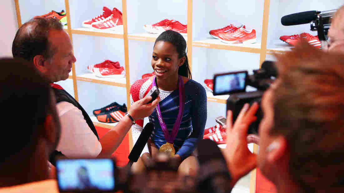 Gabby Douglas sits in the Olympic Media Lounge at Westfield Stratford City in London. During the Olympics, Douglas' Facebook fanbase grew by nearly 4,000 percent.