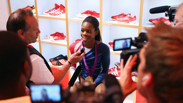 Gabby Douglas sits in the Olympic Media Lounge at Westfield Stratford City in London. During the Olympics, Douglas' Facebook fanbase grew by nearly 4,000 percent. (Getty Images for adidas)