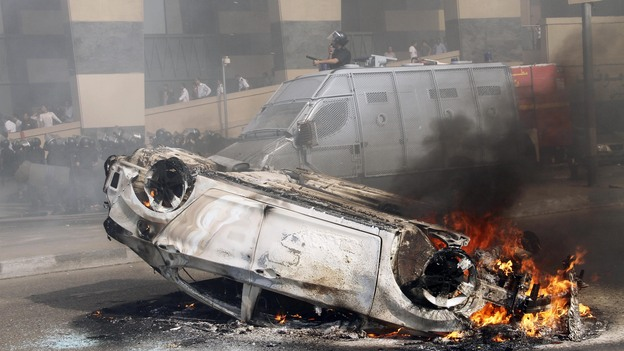 A car burns after riots break out in front of a luxury hotel in central Cairo on Aug. 2. Cairo and other parts of Egypt have seen an increase in crime and lawlessness since the country's revolution last year. (AP)