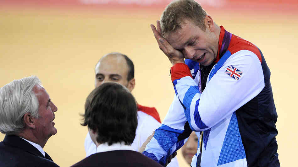 Sir Chris Hoy of Great Britain cries as he celebrates winning the men's keirin track cycling final. In shedding Olympic tears, Hoy was far from alone in Britain.