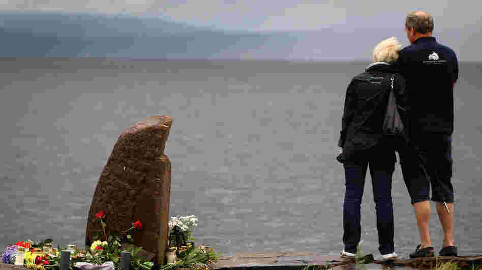 July 24, 2011: A man and woman look out across Tyrifjorden Lake towards Utoya Island, where 69 of the victims were killed.