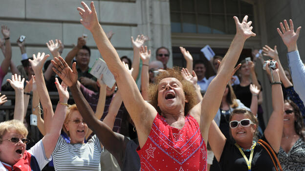 Fitness advocate Richard Simmons, wearing his signature shorts and tank top, leads Capitol Hill staff and visitors through an exercise routine July 24, 2008, in Washington, D.C. (AFP/Getty Images)