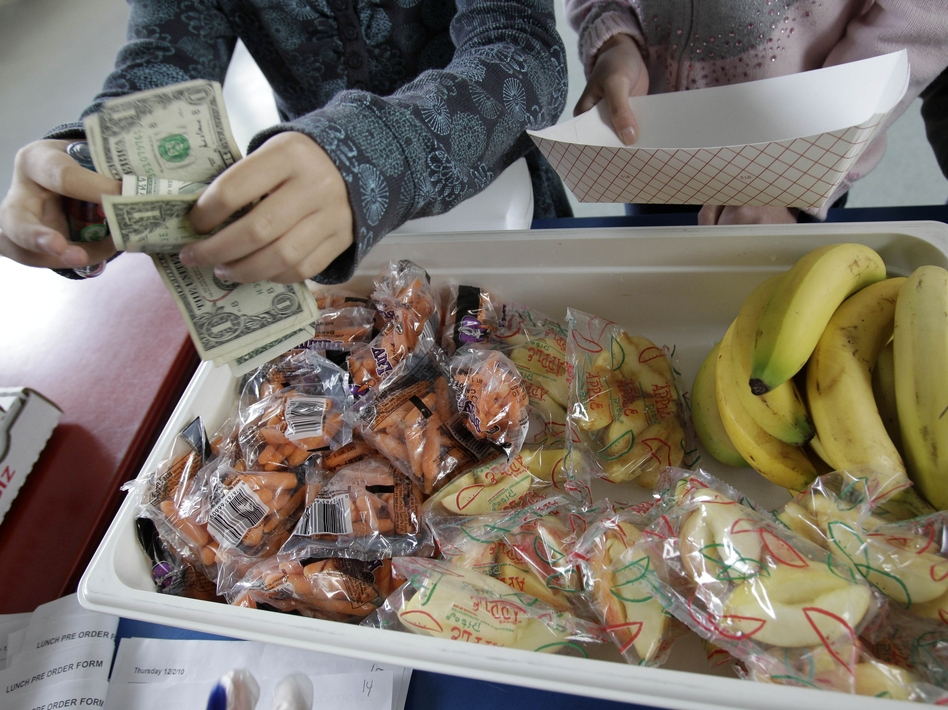 A student at Fairmeadow Elementary School buys fruits and vegetables in Palo Alto, Calif., in 2010.