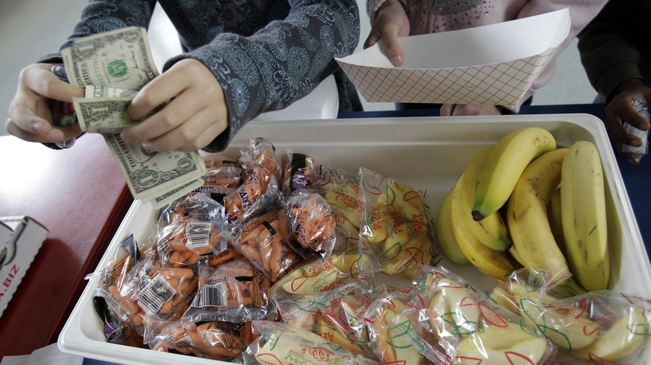 A student at Fairmeadow Elementary School buys fruits and vegetables in Palo Alto, Calif., in 2010. (AP)