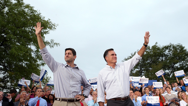 Republican presidential candidate Mitt Romney (right) and running mate Rep. Paul Ryan of Wisconsin greet supporters during a homecoming campaign rally Sunday in Waukesha, Wis. (Getty Images)