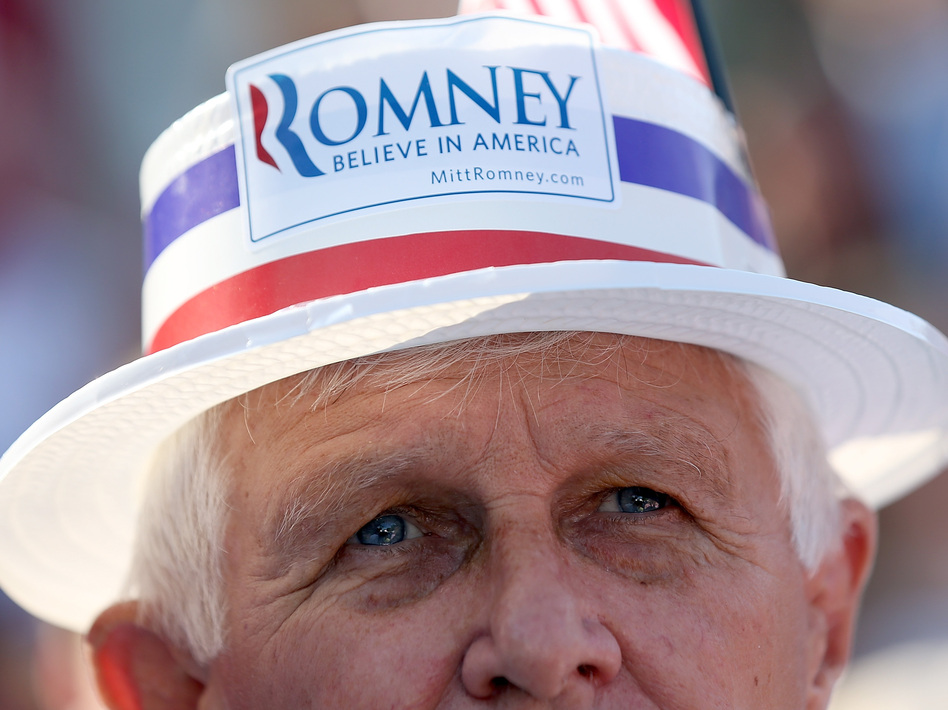 An audience member looks on during a campaign rally for GOP presidential candidate Mitt Romney in St. Augustine, Fla., on Monday. (Getty Images)