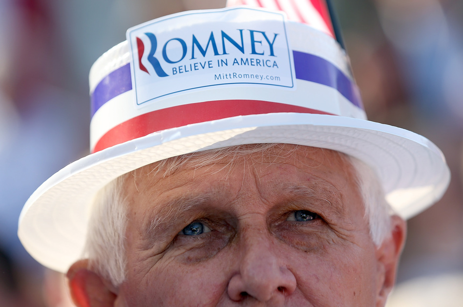 An audience member looks on during a campaign rally for GOP presidential candidate Mitt Romney in St. Augustine, Fla., on Monday.