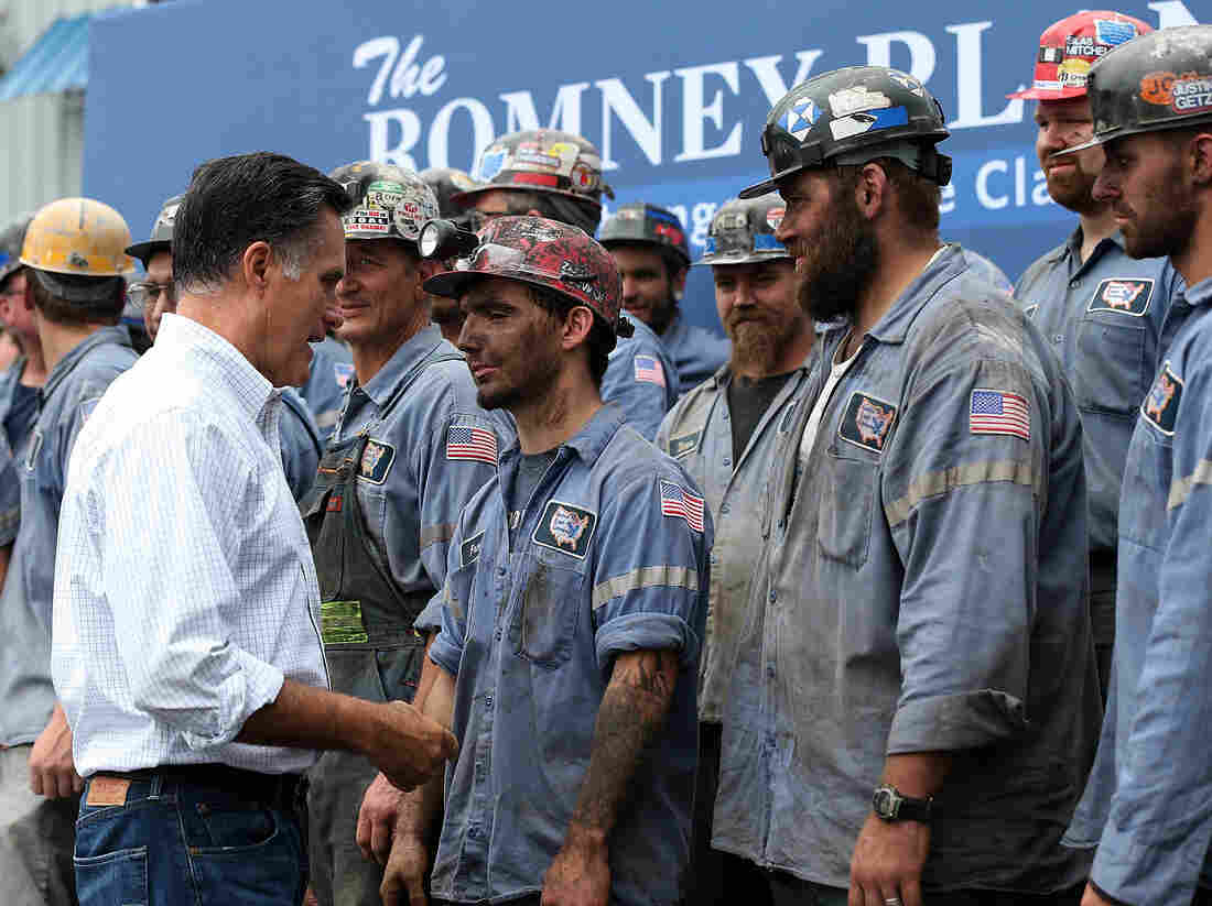 Republican presidential candidate Mitt Romney greets coal miners during a campaign rally in Beallsville, Ohio, on Tuesday.