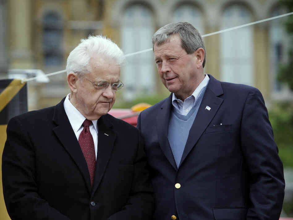 Democratic Rep. Leonard Boswell (left) talks with Republican Rep. Tom Latham on May 7, 2010, in Des Moines, Iowa. Redistricting is now pitting the longtime Iowa congressmen in a general election battle.