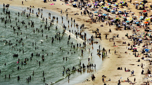 According to the National Oceanic and Atmospheric Administration, the past year through June 2012 has been the hottest year in the continental U.S. since modern record-keeping started in 1895. Above, New Yorkers flocked to Coney Island to try to beat the heat in early August. (Getty Images)