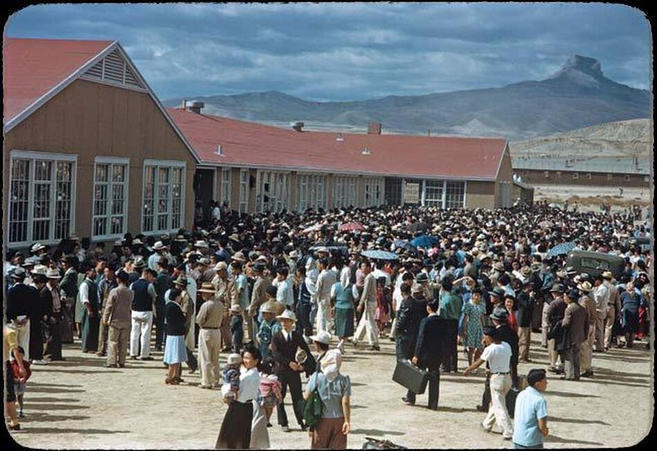 About 4,000 internees gather at the Heart Mountain camp's high school on Sept. 23, 1943, to send off 434 prisoners who failed loyalty questionnaires. The inmates were sent to a segregation facility in California. (Courtesy of Takao Bill Manbo/University of North Carolina Press/Center for Documentary Studies, Duke University)