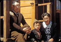 Billy Manbo sits with his maternal grandparents, Junzo (left) and Riyo Itaya.