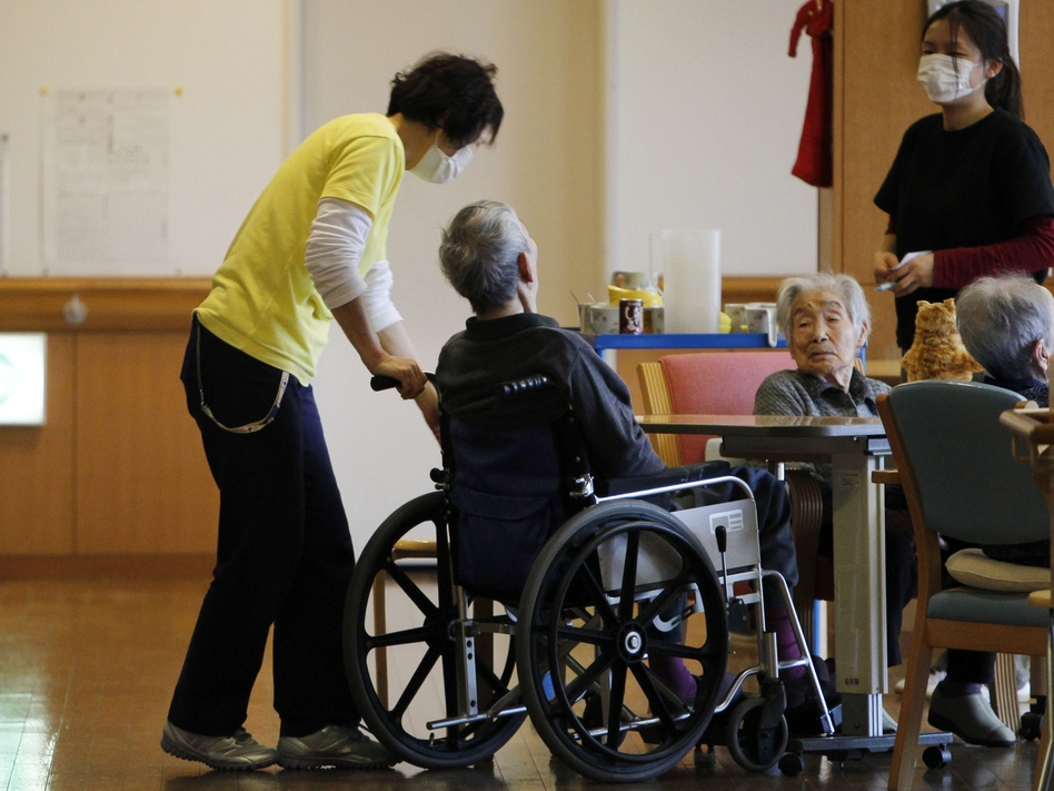 Care managers tend elderly people in March 2012 in Minamisoma, Japan. The home's residents were evacuated eight days after the Fukushima Dai-ichi nuclear power station was crippled by the March 11, 2011 tsunami.