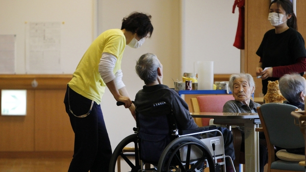 Care managers tend elderly people in March 2012 in Minamisoma, Japan. The home's residents were evacuated eight days after the Fukushima Dai-ichi nuclear power station was crippled by the March 11, 2011 tsunami. (AP)