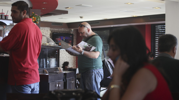 Palestinians order food at a coffee shop in the West Bank city of Ramallah on Sunday. (Tara Todras-Whitehill for NPR)