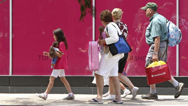 Shoppers walk along Chicago's Michigan Avenue last month. (AP)