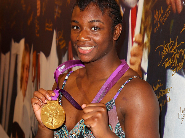 Olympian Claressa Shields visits the USA House in London before leaving for her home in Flint, Mich. Shields was greeted by a marching band and a motorcycle escort in her hometown. (Getty Images for USOC)