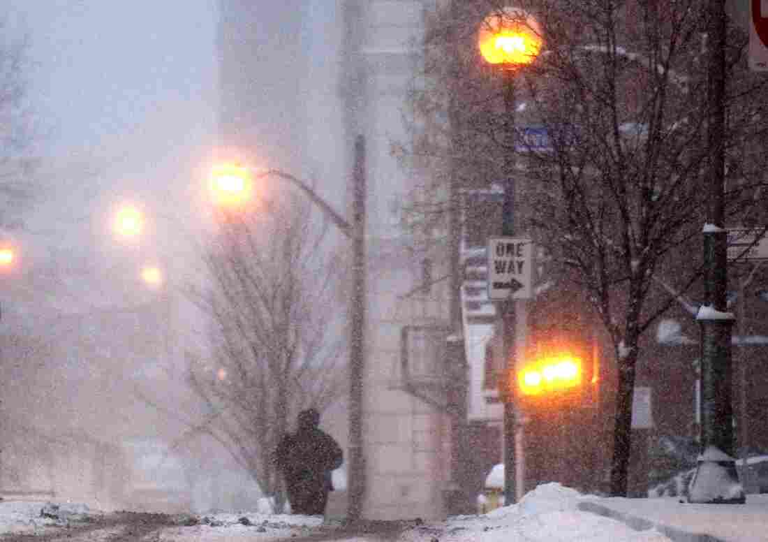 A pedestrian walks through falling snow in Pittsburgh on Jan. 12, 2011.