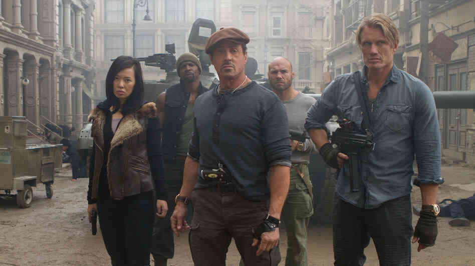 Yu Nan (front left), Sylvester Stallone, Dolph Lundgren, Terry Crews (back left) and Randy Couture are most of the hard-charging team in The Expendables 2.