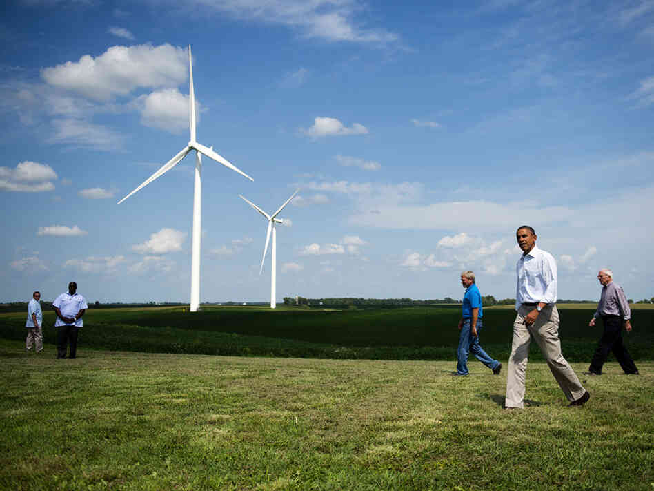 President Obama walks with members of the Heil family as he arrives to deliver remarks on wind power at the Heil Family Farm in Haverhill, Iowa, on Tuesday.